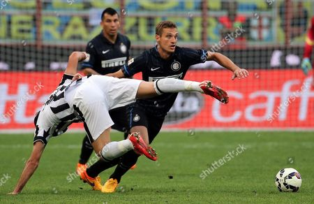 Juventus Forward Alessandro Matri (left) Challenge For the Ball with Fc Inter Defender Nemanja Vidic During the Italian Serie a Soccer Match Between Fc Inter and Juventus at Giuseppe Meazza Stadium in Milan Italy 16 May 2015 Italy Milan