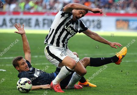 Fc Inter Defender Nemanja Vidic (left) Challenge For the Ball with Juventus Forward Alessandro Matri During the Italian Serie a Soccer Match Between Fc Inter and Juventus at Giuseppe Meazza Stadium in Milan 16 May 2015 Italy Milan