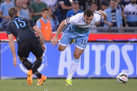 Miroslav Klose (r) of Ss Lazio Vies For the Ball with Nemanja Vidic of Inter During Italian Serie a Soccer Match Ss Lazio Vs Inter at the Olimpico Stadium in Rome Italy 10 May 2015 Italy Rome