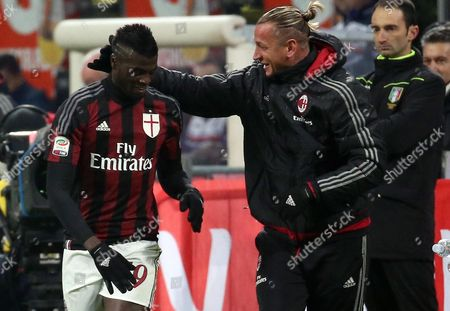Ac Milan Forward M'baye Niang (left) Celebrates with His Teammate Philippe Mexes After Scoring the Second Goal During the Italian Serie a Soccer Match Between Ac Milan and Uc Sampdoria at Giuseppe Meazza Stadium in Milan Italy 28 November 2015 Italy Milan