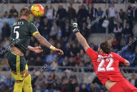 Ac Mila's Philippe Mexes (l) Scores the 0-2 Gol During Italian Serie a Soccer Match Ss Lazio Vs Ac Milan at the Olimpico Stadium in Rome Italy 01 November 2015 Italy Rome