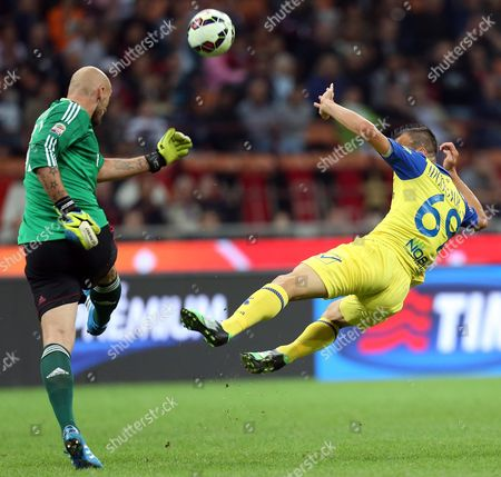 Ac Milan's Christian Abbiati (l) and Chievo's Riccardo Meggiorini in Action During the Italian Serie a Soccer Match Between Ac Milan and Ac Chievo Verona at Giuseppe Meazza Stadium in Milan Italy 04 October 2014 Italy Milan