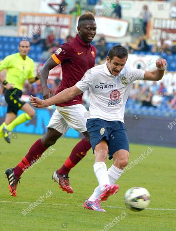 Stock Image of Juan Ignacio Gomez (r) of Hellas Verona in Action During the Italian Serie a Soccer Match Between As Roma and Hellas Verona at the Olimpico Stadium in Rome Italy 27 September 2014 Italy Rome