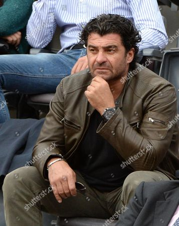 Italian Former Alpine Ski Racer Alberto Tomba Watches the Quarterfinal Match Between Serbian Tennis Player Novak Djokovic and Spain's David Ferrer For the Italian Open Tennis Tournament at the Foro Italico in Rome Italy 16 May 2014 Italy Rome