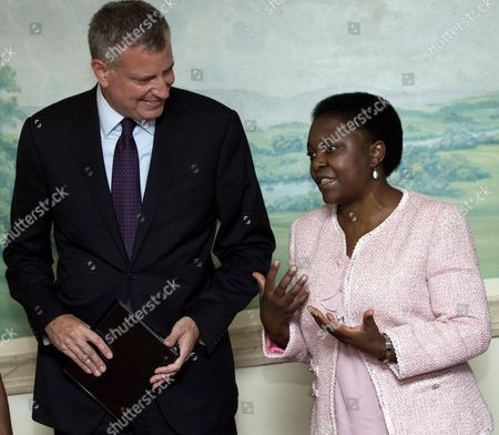 New York City Mayor Bill De Blasio (l) and Former Italian Integration Minister Cecile Kyenge (r) Talk During a Meeting in Rome Italy 21 July 2014 Blasio and His Family Are on a Private Trip to Italy on Which He and His Family Are Scheduled to Visit Grassano the Town where Blasio's Maternal Grandmother Anna Briganti Lived Before She Immigrated to the Us in the Early 1900s As Well As Sant'agata Dei Goti where the Mayor's Grandfather Giovanni De Blasio was Born Italy Rome