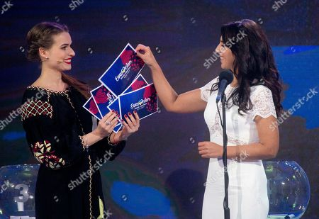 Ukrainian winner of the last year's Eurovision Song Contest, Jamala, right, draws the lots of this year's Eurovision 2017 song contest semifinals during draw ceremony at the city hall in Kiev, Ukraine, . Kiev will host the Song Contest in May 2017