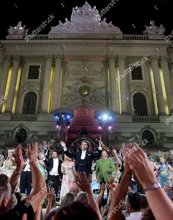 Stock Image of Dutch Star Violinist Andr? Rieu (c) Performs with His Orchestra and Guests Dagmar Koller (l Next to Rieu) and Karl Moik (r Next to Rieu) at Michaeler Square in Vienna Austria 14 July 2007 It was the First Concert to Be Held on the Square in Front of an Audience of About 3000 People Austria Vienna