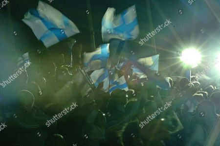 Stock Image of Spectators Wave Finnish Flags As Finland's Tommi Evila Wins Bronze in the Men's Long Jump Event at the 10th Iaaf World Championships in Athletics Helsinki Finland Saturday 13 August 2005 Finland Helsinki