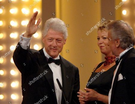 Stock Picture of Former Us President Bill Clinton in Munich where the 57th Bambi Media Awards Ceremony was Held Thursday 1 December 2005 Clinton is Shown with Actress Marion Horn (c) and Willi Weber (r) Manager of Formula One Driver Michael Schumacher the Awards Are Sponsored by the German Publisher Hubert Burda Germany M?nchen