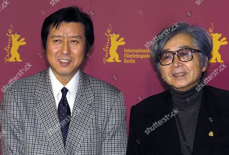 Stock Picture of Japanese Director Yoji Yamada (r) and Producer Takeo Hisamatsu Pose For the Photographers As They Arrive at the Press Conference For Their Film 'The Hidden Blade ' at the Berlinale Film Festival in Berlin Germany Tuesday 15 February 2005 the Drama Centres Around Love and Sword Fighting in Ancient Japan Germany Berlin