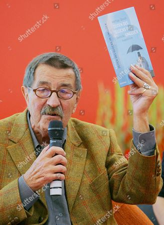 Literature Nobel Laureate Guenter Grass Shows a Book by Indian Author Amitav Ghosh at the Frankfurt Book Fair 2006 in Frankfurt Germany Friday 06 October 2006 the Two Met For a Panel Discussion in the International Centre India is Guest of Honour to the World's Biggest Book Fair Ending on Sunday 8 October Germany Frankfurt Main