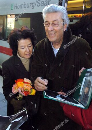 Fashion Designer Nino Cerruti Accompanied by His Longtime Partner Sibylla Jahr Signs Autographs After Arriving at the Zoo Railway Station in Berlin Germany Tuesday 08 February 2005 Cerruti is a Member of the Jury of This Year's Berlinale Filmfestival the 55th Berlinale International Filmfestival Starts on 10 February 2005 Numerous Stars Are Expected to Arrive and Festival Head Kosslick Has Promised a Glamourous Festival As Last Year's Berlinale Germany Berlin