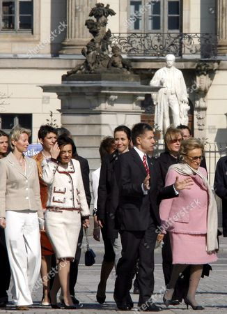 Stock Photo of Joachim Sauer (2-r) Husband of German Chancellor Angela Merkel Leads the Spouses of Eu Leaders Photini Papadopoulos (2-l) Wife of Cypriot President Natasa Karamanlis (l) Wife of Greek Premier and Bernadette Chodron De Courcel (r) Wife of French President During Celebrations to Mark the 50th Anniversary of the Treaty of Rome in Berlin on Sunday 25 March 2007 a Berlin Declaration Marking 50 Years of the European Union was Signed in the German Capital Sunday the Document Setting out the Eus Achievements and Aspirations was Signed by the Leaders of the Three Main Institutions of the Bloc That Has Grown From Six to 27 Members Since the Treaty of Rome Were Signed on This Day in March 1957 Germany Berlin