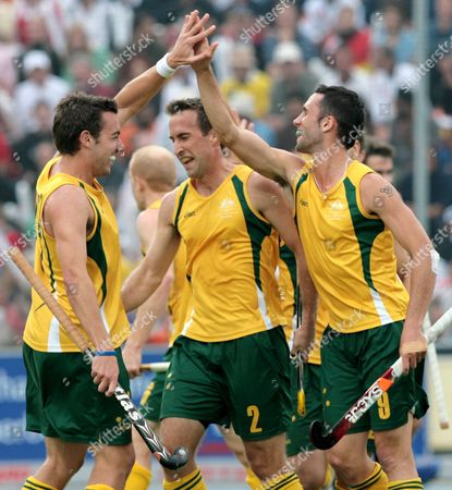 Australian Players (l-r) Michael Boyce Liam De Young and Mark Knowles Cheer After Their Team's Equalizing 1-1 Goal During the Hockey World Cup 2006 Final Between Australia and Germany in Moenchengladbach Germany Sunday 17 September 2006 Germany Moenchengladbach