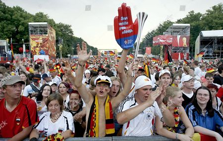Supporters of the German National Team Celebrate Prior to the 3rd Place Match of the 2006 Fifa World Cup Between Germany and Portugal on the 'Fan Fest' in Berlin Germany Saturday 08 July 2006 Epa/ Marcel Mettelsiefen Germany Berlin