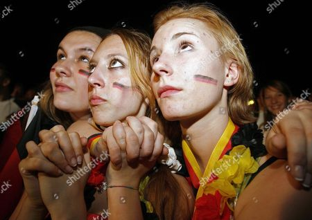 Three Young Supporters of the German National Team Watch the Match on the 'Fan Fest' in Berlin Germany Tuesday 04 July 2006 the German National Soccer Team Will Face Italy in the Semi Final Later Today in Dortmund Photo: Marcel Mettelsiefen Germany Berlin