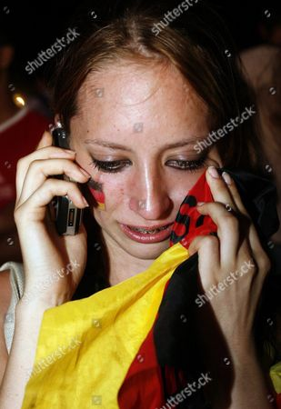 A Dejected German Supporter Does a Phone Call on the 'Fan Fest' in Berlin Germany Tuesday 04 July 2006 the German National Soccer Team Lost 0-2 Against Italy in the Semi-final Match of Fifa World Cup 2006 in Dortmund Epa/marcel Mettelsiefen Germany Berlin