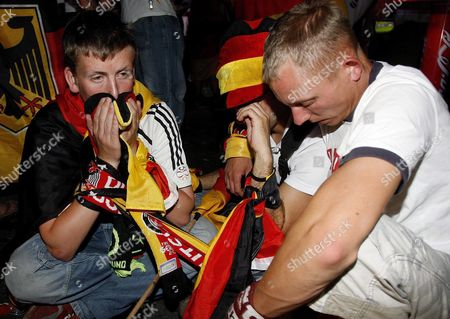Dejected German Supporters at the 'Fan Fest' in Berlin Germany Tuesday 04 July 2006 German National Soccer Team Lost 0-2 Against Italy in the Semi-final Match of Fifa World Cup 2006 in Dortmund Epa/marcel Mettelsiefen Germany Berlin