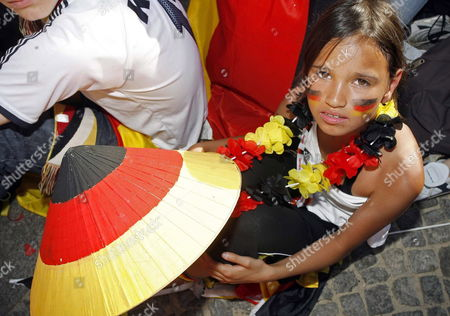 A Young Supporter of the German National Team Waits For the Beginning of the Match on the 'Fan Fest' in Berlin Germany Tuesday 04 July 2006 the German National Soccer Team Will Face Italy in the Semi Final Later Today in Dortmund Photo: Marcel Mettelsiefen Germany Berlin