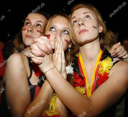 Three Young Supporters of the German National Team Watch the Semi-final Match of Fifa World Cup Germany Agianst Italy on the 'Fan Fest' in Berlin Germany Tuesday 04 July 2006 Italy Won 2-0 Epa/marcel Mettelsiefen Germany Berlin