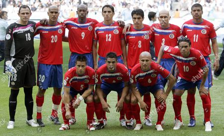 Players of Costa Rica's National Soccer Team (front Row L-r) Gilberto Martinez Michael Umana Danny Fonseca and Walter Centeno; (back Row L-r) Goalkeeper Jose Porras Douglas Sequeira Paulo Wanchope Leonardo Gonzalez Mauricio Solis Team Captain Luis Marin and Ronald Gomez Pose For Photographers Before the Opening Group a Match of the 2006 Fifa World Cup Between Germany and Costa Rica in Munich Friday 09 June 2006 Germany Munich
