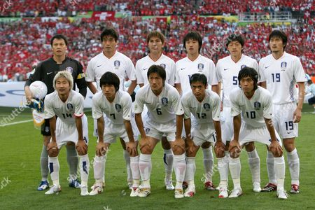 Stock Photo of Team of South Korea (back L-r) Jae Woon Lee Jin Cheul Choi Dong Jin Kim Ho Lee Nam Il Kim Jae Jin Cho (front L-r) Chun Soo Lee Ji Sung Park Jin Kyu Kim Young Pyo Lee Chu Young Park Prior to the Group G Preliminary Round Match of 2006 Fifa World Cup Between Switzerland and South Korea in Hanover on Friday 23 June 2006 Germany Hanover