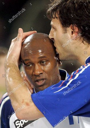 Stock Picture of France's Jerome Fernandez Receives a Kiss From Team Mate Olivier Girault After Their Main Round Group 1 Match Between France and Slovenia at the Handball World Championship in Halle Germany Thursday 25 January 2007 Germany Halle