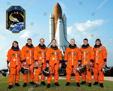 Stock Image of Attired in training versions of their shuttle launch and entry suits, these seven astronauts take a break from training to pose for the STS-126 crew portrait, Kennedy Space Center, Florida, America.