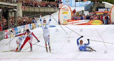 Peter Larsson of Sweden Celebrates Winning the Men's Sprint Ahead of Norway's Tor Arne Hetland (r) and Italy's Cristian Zorzi (2nd L) at the Fis Cross Country Skiing World Cup Along the Bank of the River Rhine in Duesseldorf 23 October 2004 the Artificial Loop in the City Centre is 800 Metres Long and Five Metres Wide Requiring 4 000 Cubic Metres of Snow Delivered in 160 Lorry-loads Germany D?sseldorf