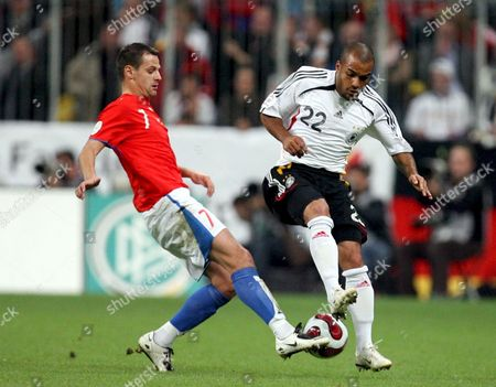 Czech Player Marek Matejovsky (l) Struggles For the Ball with German David Odonkor (r) During Their Euro 2008 Group D Qualifying Soccer Match in Munich Germany 17 October 2007 Germany Munich