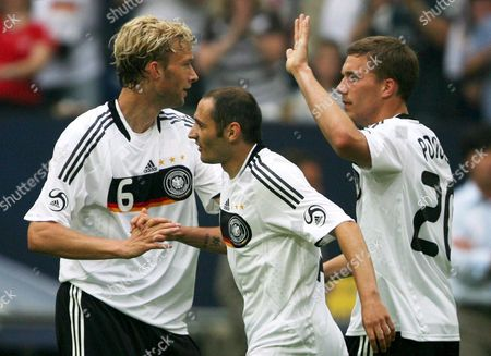 Germany's David Odonkor (l-r) Oliver Neuville and Lukas Podolski Celebrates Ballack's 2-1 During Friendly Soccer Match Germany V Serbia at the Veltins Arena in Gelsenkichen Germany 31 May 2008 Germany Won 2-1 Germany Gelsenkirchen