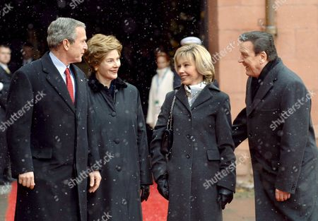 Us President George W Bush (l) and His Wife Laura (2nd From L) Are Greeted by German Chancellor Gerhard Schroeder (r) and His Wife Doris in the Courtyard of the Electoral Castle in Mainz Germany Wednesday 23 February 2005 Bush and Schroeder Want to Set Up Goals For the Future German American Collaboration Germany Mainz