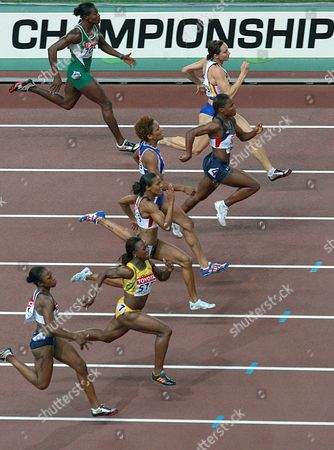 Athletes (from the Bottom) Usa's Carmelita Jeter Veronica Campbell From Jamaica Usa's Torri Edwards French Christine Arron Usa's Lauryn Williams Belgian Kim Gevaert and Oludamola Osayomi From Nigeria Are on Their Way During the Women's 100m Final at the 11th Iaaf World Championships in Athletics Osaka Japan 27 August 2007 Campbell Won the Gold Medal Japan Osaka