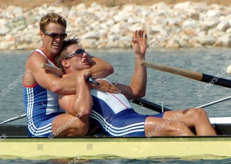 Gold Medal Winners James Cracknell (l) of Great Britain Embraces is Teammate and Country Fellowman Ed Coode (r) After Winning the Men's Four Final at the Athens 2004 Olympic Games Saturday 21 August 2004 Epa/dpa Achim Scheidemann Greece Athens