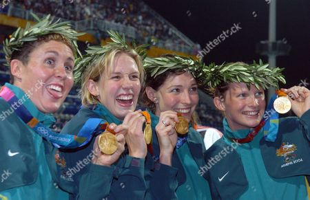 The Australian Relay Team with Petria Thomas Jodie Henry Giaan Rooney and Leisel Jones (from L) Show Off Their Gold Medals in the Medal Ceremony of Women's 4x100m Medley Relay Final at the Athens Olympic Aquatic Centre Saturday 21 August 2004 Team Australia Set a New World Record in the Medley Relay Epa/dpa Andreas Altwein Greece Athens