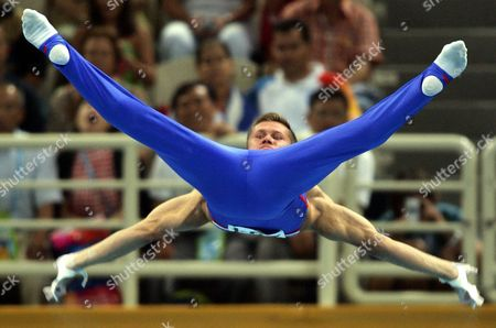 Alexei Nemov of Russia Performs His Routine in the Men's Horizontal Bar Final in the Gymnastics Artistic Events in the Olympic Indoor Hall at the Athens 2004 Olympic Games Monday 23 August 2004 Epa/dpa Gero Breloer Greece Athens