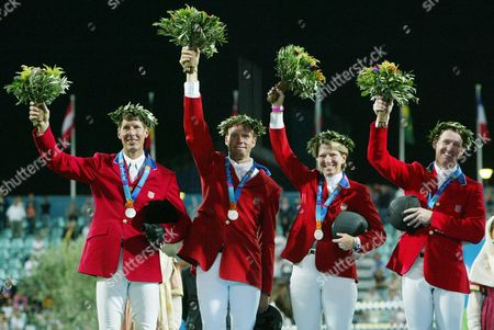 The Us Horseriding Team with with Chris Kappler Peter Wylde Beezie Madden and Mclain Ward (l to R) Greet the Crowd After Taking the Silver in the Team Jumping at the Athens 2004 Olympic Games at Markopoulo Equestrian Center Tuesday 24 August 2004 Epa/dpa Jens Wolf Greece Athen