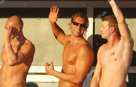 Australian Swimmers Ian Thorpe (c) Michael Klim (l) and Regan Harrisson (r) Wave to the Crowd in the Warm Evening Sunlight While Watching the Evening Events at the Athens Olympic Aquatic Centre Thursday 19 August 2004 Epa/dpa Kay Nietfeld Greece Athens
