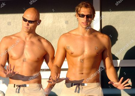 Australian Swimmers Ian Thorpe (r) and Michael Klim Enjoy the Warm Evening Sunlight While Watching the Events at the Athens Olympic Aquatic Centre Thursday 19 August 2004 Epa/dpa Kay Nietfeld Greece Athens