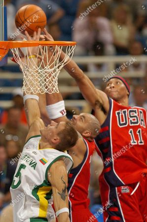 Mindaugas Zukauskas (l) From Lithuania Vies For the Ball with Carlos Boozer (c) and Shawn Marion (r) of the United States During the Us Vs Lithuania Mens Basketball Bronze Medal Match at the Athens 2004 Olympic Games in Athens Saturday 28 August 2004 Epa/dpa/peter Kneffel Greece Athens