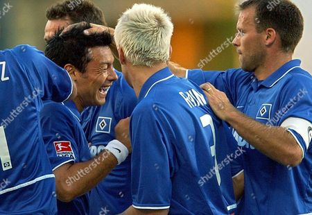 Hamburg Sv Player Rodolfo Cardoso (2nd L)is Congratulated by His Colleagues After Scoring During Their German Bundesliga Cup Final Match Against Borussia Dortmund in Mainz on Monday 28 July 2003 Epa Photo/dpa/boris Roessler Germany Mainz