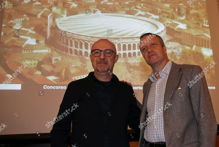 Verona major Flavio Tosi, right is flanked by president of Calzedonia group Sandro Veronesi as they pose with the rendering image of the winning project to cover the Arena of Verona, in Milan, Italy, . A controversial project to cover the Verona Arena has nudged forward with the announcement that a German proposal has won a competition for the best proposal to shield the ancient Roman amphitheater from rain. The 13.5-million-euro ($14.5-million) proposal by engineering firm Schlaich Bergermann & Partner and Gergan Marg & Partners architectural firm calls for a curtain membrane that would be extended on cables in case of rain, with minimal visibility when retracted