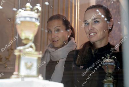 Iva Majoli, Martina Hingis Tennis players Iva Majoli, left, and Martina Hingis look at exhibits during their visit to the Faberge Museum in St.Petersburg, Russia, . The tennis players are here for the St. Petersburg Ladies Trophy-2017 tennis tournament which will end Sunday, Feb. 5