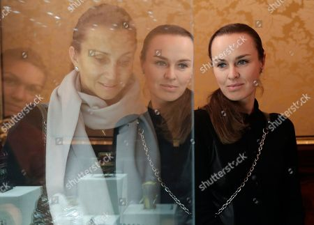 Iva Majoli, Martina Hingis Tennis players Iva Majoli, reflected left, and Martina Hingis look at exhibits during their visit to the Faberge Museum in St.Petersburg, Russia, . The tennis players are here for the St. Petersburg Ladies Trophy-2017 tennis tournament which will end Sunday, Feb. 5