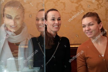 Iva Majoli, Martina Hingis, Simona Halep Tennis players Iva Majoli, reflected left, Martina Hingis, centre, and Simona Halep look at exhibits during their visit to the Faberge Museum in St.Petersburg, Russia, . The tennis players are here for the St. Petersburg Ladies Trophy-2017 tennis tournament which will end Sunday, Feb. 5