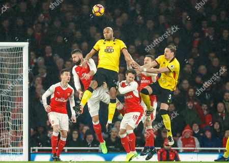 Younes Kaboul of Watford jumps higher than the Arsenal defence during the Premier League match between Arsenal and Watford played at The Emirates Stadium, London on 31st January 2017