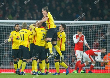 Younes Kaboul of Watford celebrates scoring a goal with team mates after making it 0-1 during the Premier League match between Arsenal and Watford played at The Emirates Stadium, London on 31st January 2017