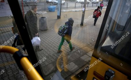 Passengers walk on a tram stop in Warsaw, Poland, 31 January 2017. Mayor of Warsaw, Hanna Gronkiewicz-Waltz announced on 31 January, that over 150 thousand primary and secondary students in Warsaw, can ride public transportation for free from 01 September 2017. The main aim of the project is to reduce the number of cars on the streets and accustom students to using public transport.
