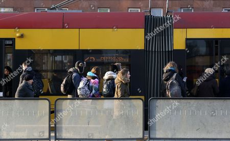 Passengers wait on a tram stop in Warsaw, Poland, 31 January 2017. Mayor of Warsaw, Hanna Gronkiewicz-Waltz announced on 31 January, that over 150 thousand primary and secondary students in Warsaw, can ride public transportation for free from 01 September 2017. The main aim of the project is to reduce the number of cars on the streets and accustom students to using public transport.