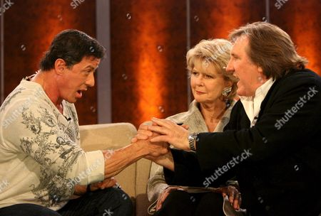 Us Actor Sylvester Stallone (l) Welcomes French Actor Gerard Depardieu (r) As Austrian Actress Christiane Hoerbiger (c) Looks on During the German Language Tv Show 'Wetten Dass ?' (bet That ?') in Salzburg Austria Late 26 January 2008 the German Language Tv Show Hosted by Entertainer and Actor Thomas Gottschalk is Produced by German Television Channel Zdf Austria Salzburg